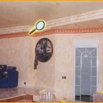 Elegante salón, conjugando acabados de alta decoración: -Marmolizado en cornisa -Drapeado en techo -Revestimiento esfumino en paredes -Estuco veneciano en columna -Cenefa decorativa de papel